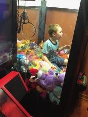 Boy gets stuck in arcade game in Titusville.