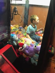 Needless to say, the boy left the arcade with the stuffed