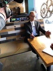 Ron Witman talks to the media Thursday, Feb. 8, 2018,