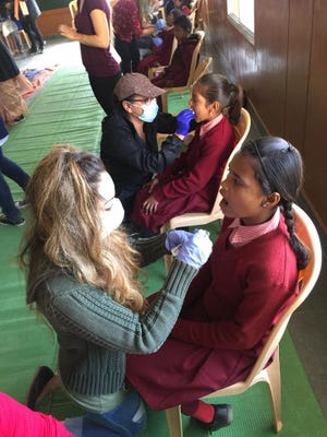 DACC students work with children from India