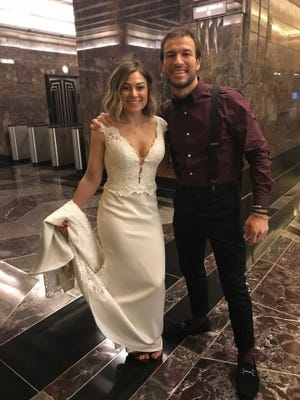Alix Cirigliano and Brett Epps arrive on Valentine's Day at the Empire State Building, where they renewed their marriage vows.