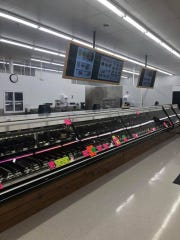 The new Fareway grocery store on Fleur Drive features television screens in the meat department.