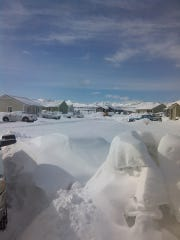 A neighborhood on the Blackfeet Reservation is nearly paralyzed by chest high snowdrifts