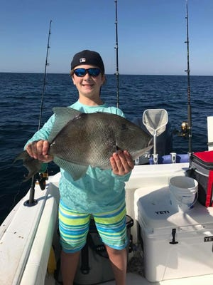 Local angler Dylan Seeker with a nice triggerfish he caught while fishing with Captain Andy Arnold with Hot Spots Charters.