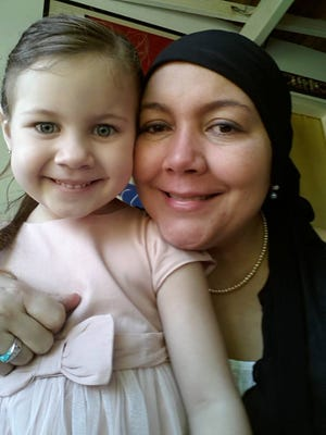 Anabella, a participant in the Imagine program, with her mom, who was dying.