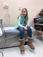 Aubreigh makes a silly face during a doctor's appointment.