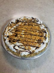 Amber Muehlbauer's pies have become one of the most popular items at Amber's Colby Cafe in Colby. This is her butterfinger pie shown here.
