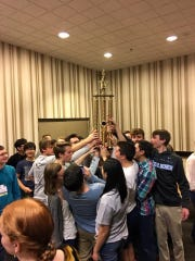 Knoxville Symphony Youth Orchestra members with trophy.