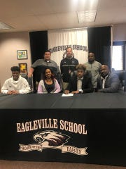 Eagleville football standout Antonio Turrentine recently signed with the University of the South. Pictured in the front row (l-r) are Andre Turrentine, Jajuan Turrentine, Antonio Turrentine and Antonio Turrentine Sr. In the back row are Eagleville principal Bill Tollett, Eagles AD Jason Brown and Eagleville football coach Floyd Walker.