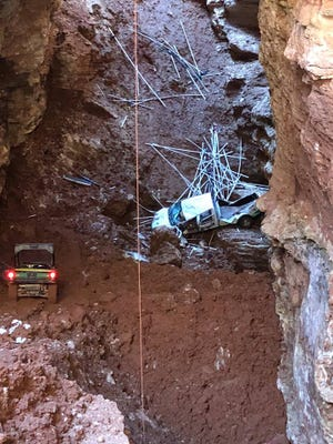 Officials say a pickup truck fell about 100 feet Wednesday into a sinkhole at Top of the Rock.
