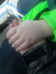 Casey Dunn holds her son's hand in a posed photo after an incident that happened at Stigall Primary School in Humboldt, Tenn.