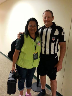 Barb Kowalczyk of De Pere grabs a photo with popular NFL referee Ed Hochuli at Lambeau Field. As the referee technician at Packers home games, Kowalczyk got to know Hochuli, who recently announced his retirement.