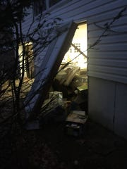 Ramapo police said a newspaper delivery driver crashed into a home on Greenridge Way on March 23, 2018. Shown here is the resident's car, which police said was hit by the deliver driver and pushed into the opposite wall of the home.