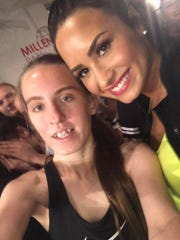 Autum Rene, left, is pictured with singer Demi Lovato.