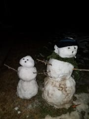 A pair of snowmen at the residence of Caelan Hoisington, 6, Annville.   The larger snowman, which was built by Hoisington and his family, was kicked over by someone the day it was built, March 22. Officer Jason Cleck of the Annville Township Police Department rebuilt the snowman and built a second snowman for Hoisington.
