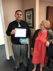 Jason Zigrand accepts a gift of recognition on behalf of Florida Community Bank from Devereux Community Based Care CEO Carol Deloach.