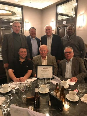 The National Federation Officials Association honored veteran New Jersey baseball umpire Bill Kilduff (front center) with its prestigious Official of the Year award.