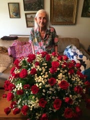 Josephine Regmund on her 99th birthday in June 2016. Her family got her 99 roses.