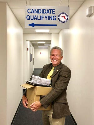 Phil Ehr poses for a photo as he turns in voter petitions to the Escambia County Supervisor of Elections office.
