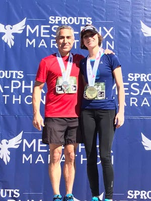 Andrew and Haley Chinarian shown after the Phoenix Marathon in February.