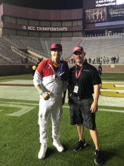 FSU Associate Athletic Director Jason Dennard, right, with rapper Vanilla Ice following last year's concert at Doak Campbell Stadium.