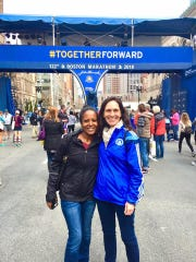 Tsige Tadesse, left, and Birgit Maier-Katkin at the Boston Marathon finish line a day before the race.