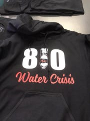 As Michigan ends a free bottled-water program in Flint, the Flint Elite AAU basketball team calls attention to it with the 810 on their clothes. 810 is the area code for Flint, Mich.