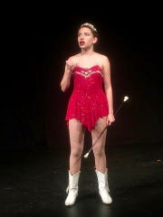 "Ta'sina Copeland in ""Twirler"" as a former champion"
