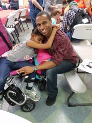 Neveah Schofield, 11, gives a hug to her buddy Chris Trice.