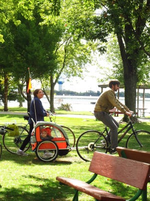 A family enjoys a pleasant summer's day ride at Pfiffner Park in Stevens Point.