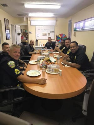 Local first responders enjoy a relaxing meal at the offices of Century 21 All Professional during last month's appreciation day.
