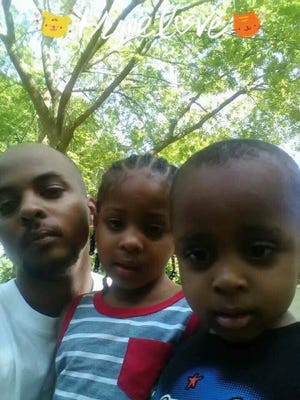 Cleon Baker with his children.