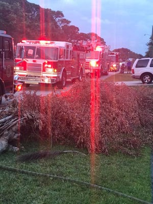 St. Lucie County Fire District crews respond to a house fire in the 500 block of Southwest Violet Avenue in Port St. Lucie on Thursday, May 3, 2018.