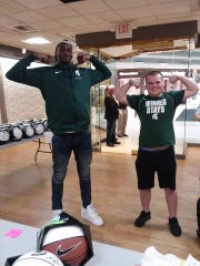"""Sparty Mike"" or Mike Sterner, as he is known to his friends and family, flexes with former Michigan State forward, Jaren Jackson Jr., at an autograph signing May 4 at Laurel Park Place."