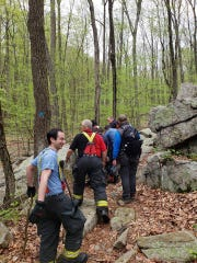 First responders navigate off a path at Schooley's Mountain Park to reach an injured hiker. May 6, 2018.