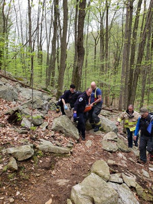 First responders carry an injured hiker off a path at Schooley's Mountain Park. May 6, 2018.