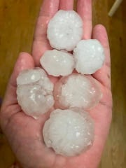April McVeigh holds hail that fell in Stewartstown during a severe thunderstorm this evening.
