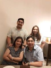 The Biala family take a family photo.