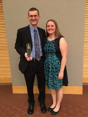 Whitinger & Company member/owner T.J. Bush (left) recently received the Emerging Leader Award from the Paul W. Parkison Department of Accounting at Ball State University.