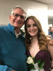 Frances Anne Fortner (right) poses for a picture with her dad, Tom Fortner.
