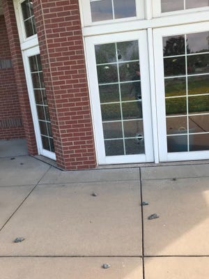 A window was broken at the Frances L. Simek Memorial Library during a string of property damages in Medford on Friday night and Saturday morning.