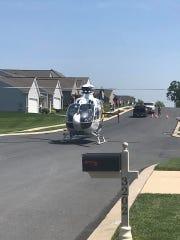 A helicopter arrives to the Fair Wynd neighborhood
