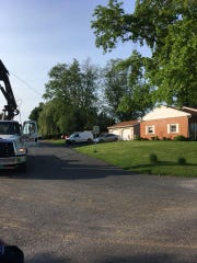 A delivery truck with a knuckle boom extended and entangled in electric wires at the intersection of Reigerts Lane and Lancaster Street in South Annville Township at 5:22 p.m. May 23, 2018. Wires and poles were down throughout the development including live wires down on structures and in yards.