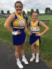 Julianna Gundrum, left, with her sister Adreanna in their cheer uniforms at Northern Lebanon School District during the 2017-18 school year.