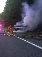 Yorktown firefighters battled a car fire on the Taconic