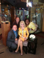 Mike McCormick, former WYFF photographer Nick Gosnell, and Akili Franklin with Dolly Parton