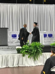 Jack Clarke, right, receives his diploma during the