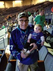 Knighthawks fan Ed DiPonzio of Greece and his granddaughter,