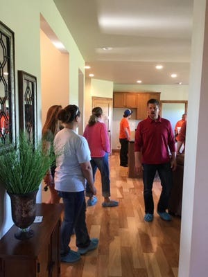 A group tours the home for sale built by students enrolled in the Door County High School Home Construction Program June 1, 2018.