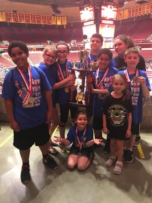 All Saints Elementary School students took second place in the Odyssey of the Mind World Finals Competition.